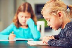 Siblings are doing homework Stock Image