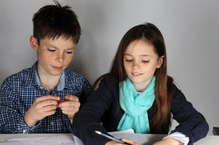 Siblings doing maths homework Stock Photos