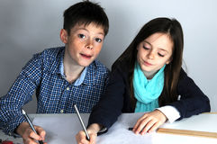 Siblings doing maths homework Royalty Free Stock Image