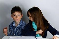 Siblings doing maths homework Royalty Free Stock Image