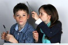 Siblings doing maths homework Royalty Free Stock Photos