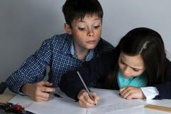 Siblings doing school homework Royalty Free Stock Photos