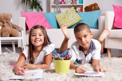Siblings drawing at home Stock Photography