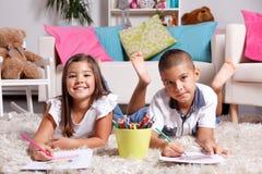 Siblings drawing at home Stock Photography