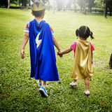 Siblings Dressup Playtime Park Concept Stock Photography