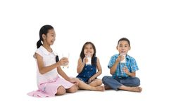 Siblings drinking milk Stock Photo