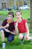 Siblings. Eating colorful big lollipops Royalty Free Stock Image