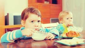 Siblings eating dairy breakfast Stock Photo