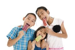 Siblings eating ice creams Stock Image