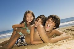 Siblings Enjoying On Beach Stock Photos