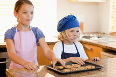 Siblings enjoying cookies together Royalty Free Stock Photo