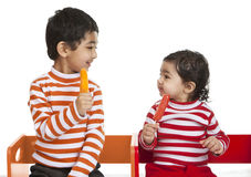 Siblings Enjoying Popsicles Royalty Free Stock Photography