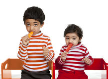 Siblings Enjoying Popsicles Stock Images