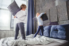 Siblings fighting with pillows Stock Image