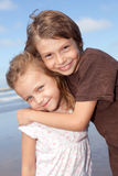 Siblings and friends. Portrait of two adorable kids hugging and smiling Royalty Free Stock Images