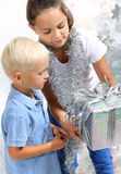 Siblings with gift Royalty Free Stock Image