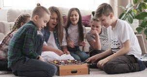 Siblings having fun playing foosball at home. Brothers and sisters having fun while playing foosball at home stock video