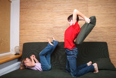 Siblings having pillow fight Royalty Free Stock Images