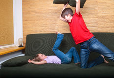 Siblings having pillow fight Royalty Free Stock Photography