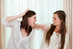 Siblings het vechten Stock Afbeeldingen
