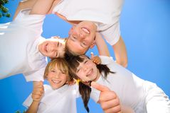 Siblings hold together. Four young siblings hold together Stock Photography