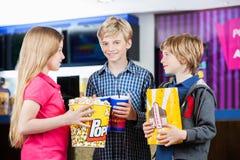Siblings Holding Snacks At Cinema Royalty Free Stock Photo