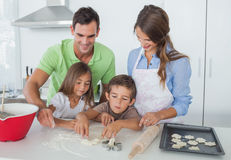 Siblings home baking together in the kitchen royalty free stock photo