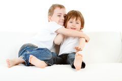 Siblings hugging Royalty Free Stock Images