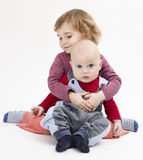 Siblings isolated in light background royalty free stock images