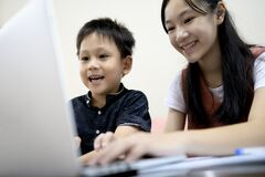 Free Siblings Kid Boy And Child Girl Are Enjoying Playing Online Game On Laptop Computer,asian Sister,little Brother Having Fun Stock Photography - 181998902