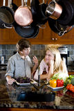Siblings in kitchen chatting Royalty Free Stock Images