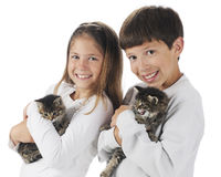 Siblings with Kittens Stock Image
