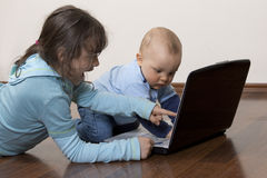 Siblings with laptop Stock Photography