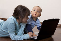 Siblings with laptop Royalty Free Stock Photo