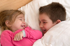 Siblings Laughing Each Other Stock Images