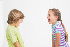 Siblings laughing on white background Royalty Free Stock Photos