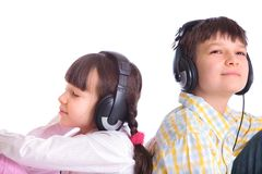 Siblings listening to music Stock Images