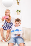 Siblings in a living room Stock Photo