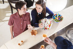 Siblings Looking At Each Other At Counter In Icecream Shop Royalty Free Stock Images
