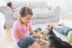 Siblings lying on rug with their yorkshire terrier Royalty Free Stock Images