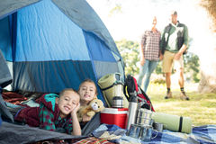 Siblings lying in the tent. Portrait of siblings lying in the tent Royalty Free Stock Photos