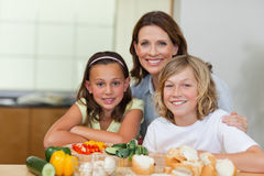 Siblings and mother making sandwiches Stock Photography