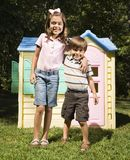 Siblings outside. Royalty Free Stock Photo