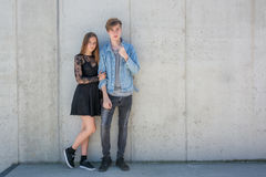 Siblings over urban background with copyspace. Siblings brother and sister posing together as teenage fashion models of boy and girl, full legth with copyspace Stock Photography