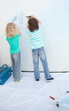 Siblings painting a wall Royalty Free Stock Photography