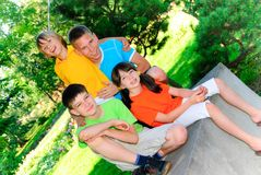 Siblings in the park. Four siblings together in park Royalty Free Stock Image