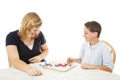 Siblings Play Board Game royalty free stock images