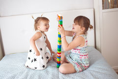 Siblings play in constructor, in real interior Royalty Free Stock Images