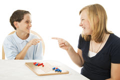 Siblings Play Games Stock Photo