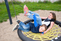 Siblings at the playground Royalty Free Stock Images